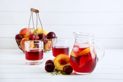 Iced fruit compote with peaches and plums. Cold summer drink. Royalty Free Stock Images