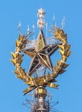 Iced golden star of Moscow State University on the blue sky background Stock Photo