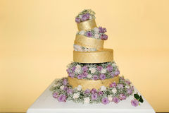 Iced Golden Wedding Cake - Real Roses Decoration Royalty Free Stock Photography