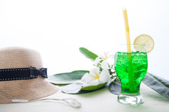 Iced green color drink on white background with plumeria flower Stock Photography