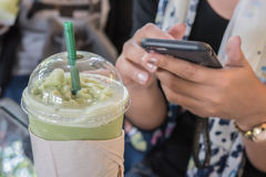 Iced green. Girl Casual Activity Chilling Relaxation Outdoor Concept and Iced green tea latte on the table in coffee shop royalty free stock photo