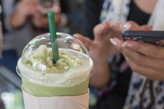 Iced green. Girl Casual Activity Chilling Relaxation Outdoor Concept and Iced green tea latte on the table in coffee shop royalty free stock photos