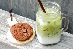 Iced green tea latte and chocolate cookies Stock Image