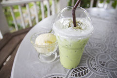 Iced green tea latte and vanilla ice cream Royalty Free Stock Photo