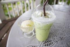 Iced green tea latte and vanilla ice cream Royalty Free Stock Photo