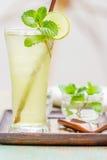 Iced green tea with lime garnish Stock Photos