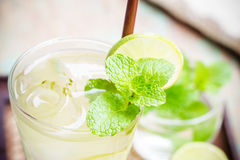 Iced green tea with lime garnish. And ice cube stock photos