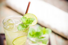 Iced green tea with lime garnish. And ice cube royalty free stock image