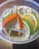 Iced green tea with orange and lime Royalty Free Stock Photo