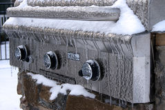 Iced Grill. Ice covers the outdoor grill after the winter storm Royalty Free Stock Photos