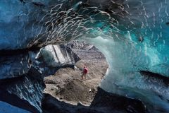 Iced grotto. Ice cavern in glacier in the Chile mountains stock photography
