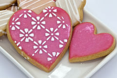 Iced heart shaped cookies. Royalty Free Stock Images