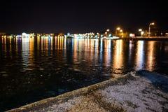 Iced lake at night road Stock Photos