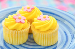Iced lemon cupcakes Stock Photography