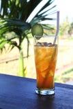 Iced lemon tea. A cool refreshing glass of iced lemon tea on a hot day Stock Images