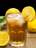 Iced lemon tea over wood table Royalty Free Stock Photography