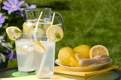 Iced lemonade. Two glasses of home made iced cold lemonade and pitcher on hot summer. Copyspace Royalty Free Stock Images
