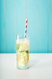 Iced lemonade with big red striped straws Royalty Free Stock Images