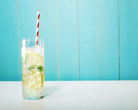 Iced lemonade with big red striped straws Royalty Free Stock Image