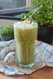 Iced matcha latte. On decorative background Stock Photo