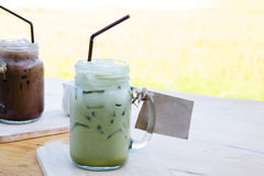 Iced milk in  jar, mug glass cups on the table. Stock Images