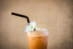 Iced Milk Tea. On a brown wooden table in summer royalty free stock photography