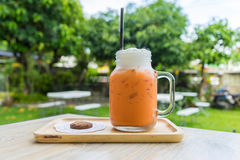 Iced milk tea with cookie stock images