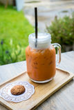 Iced milk tea with cookie Royalty Free Stock Images