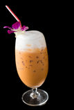 Iced Milk Tea. Thai Traditional Iced Milk Orange Tea isolated on black Royalty Free Stock Photos