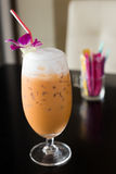 Iced Milk Tea. Thai Traditional Iced Milk Orange Tea isolated on black Stock Images