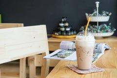 Iced milk tea. On wood table stock image