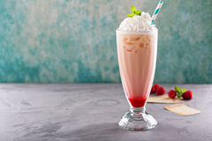 Iced milkshake with raspberry syrup and whipped cream Royalty Free Stock Photo