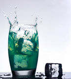 Iced mint flavored drink splash Stock Photos