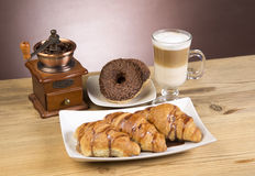 Iced mocha coffee with croissants. On wooden table with purple background royalty free stock photo