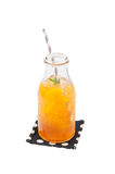 Iced peach tea in glass bottle Royalty Free Stock Images