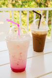 Iced pink milk and iced coffee in plastic cup. S stock photos