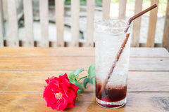 Iced pomegranate drink on wood table Stock Image