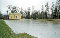 Iced pond and classical buiding Royalty Free Stock Photography