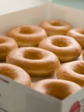 Iced Ring Doughnuts In A Tray.  stock photo