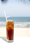 Iced soda drink in a glass on sea background Stock Image
