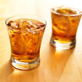 Iced southern sweet tea with lemon slices. Close up photo of two glasses of iced southern sweet tea with lemon slices stock image