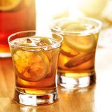 Iced southern sweet tea with lemon slices. Shot with selective focus and sunlight in background Royalty Free Stock Images