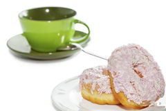 Iced and sprinkled donuts and coffee cup Stock Image