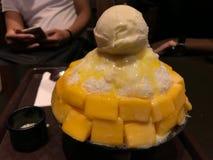 Iced sweetened condensed milk Korean bingsu with sliced mangoes and vanilla ice cream. On top Royalty Free Stock Image