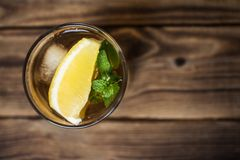 Iced tae with fresh lemon and mint Royalty Free Stock Photos