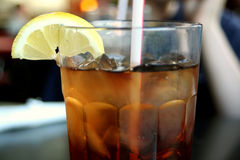 Iced Tea #2. Top half side view of a glass of iced tea, with a lemon and straw stock photo