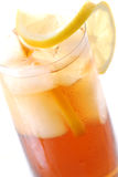 Iced tea. Glass of cold iced tea with water drops on surface stock photos