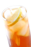 Iced tea. Glass of cold iced tea with water drops on surface, focus on the drops royalty free stock image