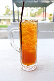 Iced Tea And White Tube In Glass. Royalty Free Stock Photo