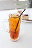 Iced Tea And White Tube In Glass. Royalty Free Stock Photos